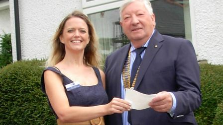 Letchworth Howard Rotary Club president Colin Green presents the donation cheque to Garden House Hos