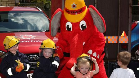 Logan Cullen, 5, Ethan, 5 and Lottie Cole, 2 meet Welephant at Hitchin Fire Station Open Day. Pictur