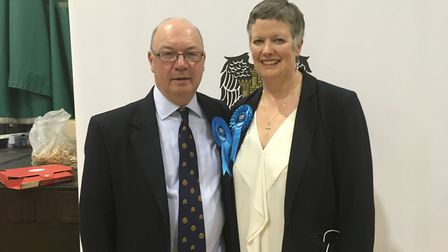 Conservative Alistair Burt, pictured with his wife Eve, has retained his North East Bedfordshire sea