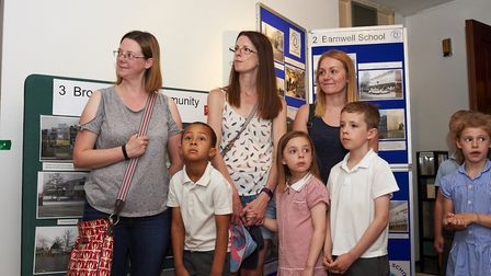 Staff from Stevenage Museum and schools with pupils at the exhibition launch