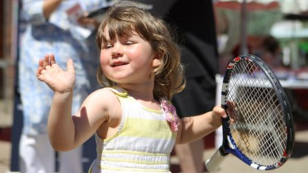 Three-year-old Willow Egett enjoys the tennis.