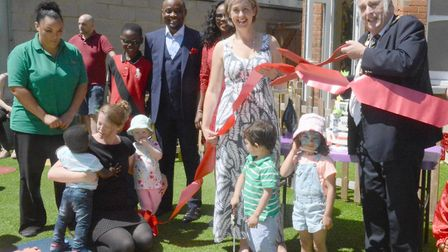North Herts District Council chairman Alan Millard cuts the ribbon for the one-year anniversary of t