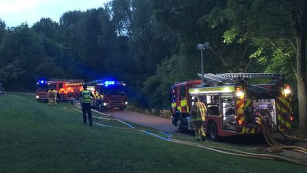Firefighters at the scene of the fire in Fairlands Valley Park, Stevenage. Picture: Danny Loo