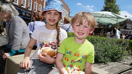Ciara McDermott, eight, and four-year-old Callum McDermott enjoying the food. Picture: Kevin Lines