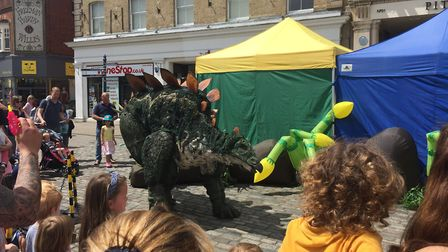 Tiny the Stegosaurus makes a dramatic entrance in Hitchin's Market Place. Picture: Dalia Asher