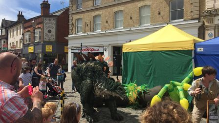 Palaeontologist Susanna Stone and Tiny the Stegosaurus in Hitchin's Market Place. Picture: JP Asher