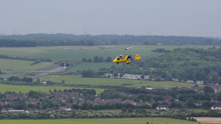 David Taylor in his autogyro, as captured by Comet photographer Danny Loo during his own flying expe