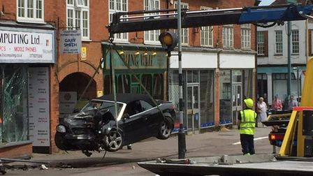 The Audi A4 being recovered after crashing into iFix Computing in the early hours of this morning. S