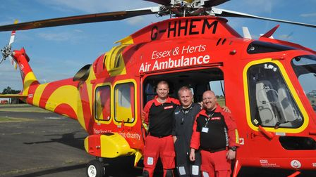 Pilot Jim Lynch and paramedics Scott McIlwaine and Ben Myer pose beside the new Essex & Herts Air Am