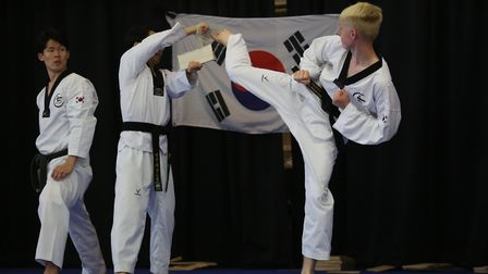 Visitors from a taekwondo gym in South Korea during a demonstration at Fairlands Primary and Junior
