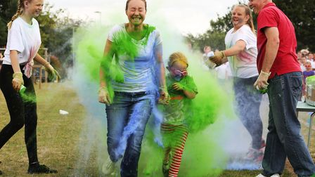 Catherine Everett and daughter Anna, 5 officially start the colour run at Roebuck Primary School to