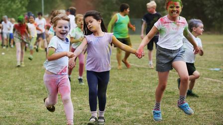 Children from Roebuck Primary School take part in a colour run to raise money for Scott Everett's mo