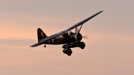 A Second World War-era Westland Lysander aircraft flying during the airshow at Shuttleworth on Satur