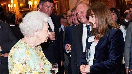 DLRC Ltd directors Dianne Lee and Kevin Judges, from Letchworth, meet the Queen at Buckingham Palace