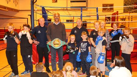 Box Cleva patron John Conteh with coaches George Luis, Wayne Armstrong and children from the Stevena