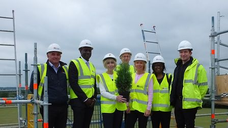 Headteacher Jude Lovelock with members of the construction team on top of the school's new building.