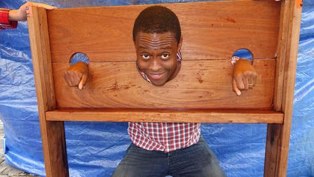 Good sport Bim Afolami - MP for Hitchin and Harpenden - in the stocks as part of a scouts adventure