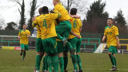 Brett Donnelly of Hitchin celebrates scoring Hitchin's second goal with team mates
