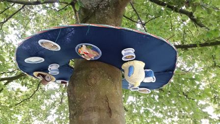 The Mad Hatters Tea Party-inspired yarn bomb.