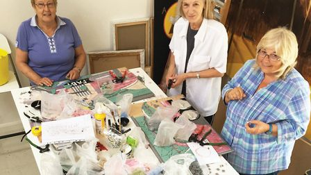 The team working on one of the mosaics