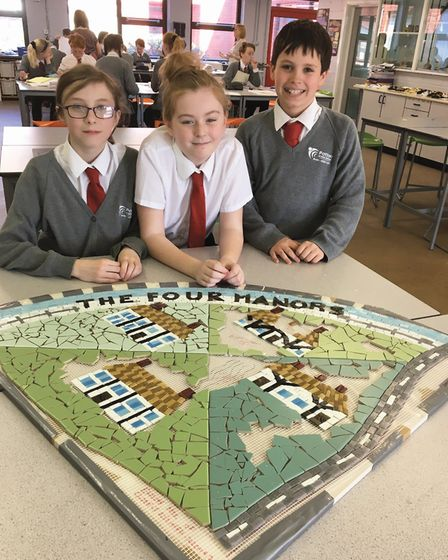 Pupils working on one of the mosaics