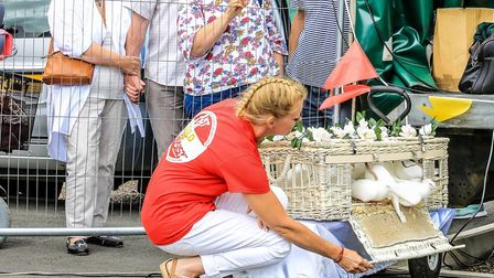 Dr Shiv Sekaran's wife Melissa releases doves at the memorial day. Picture: Karen Brammer