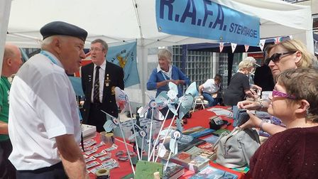 Members of the Stevenage branch of the Royal Air Force Association talking to people in Stevenage T