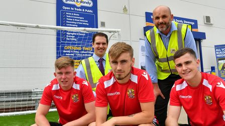 Stevenage FC players Mark McKee, Luke Slater and Jamie Gray with Gibbs and Dandy sales director Andr