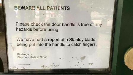A warning sign has been put up at the door to The Poplars Surgery in Stevenage.