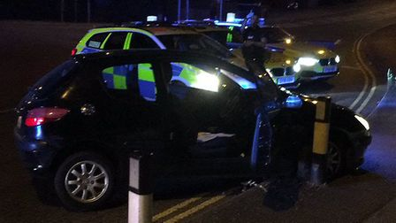 The car on the side of the A505 in Luton after hitting the bollard at the Vauxhall Way roundabout. P