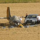 A vintage aircraft was forced to land in a field during the IWM Duxford air show over the weekend. P