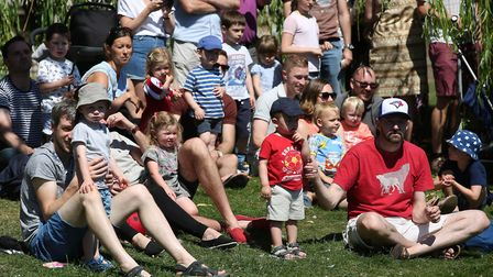 Families gather on the banks of the River Hiz to watch the Hitchin Duck Race. Picture: Danny Loo