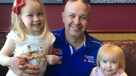 Five-year-old Anna, pictured with her sister Evie and dad Scott Everett, is taking part in a sponsor