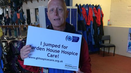 Chris Phillips, of Phillips Digital Print in Letchworth, after his jump. Picture: Garden House Hospi