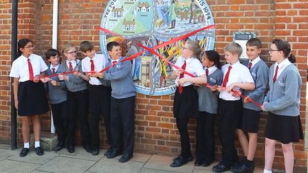 Pupils from the Federation Schools unveiling the mosaic in Potton