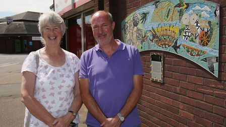 Contributor Ros Hill and Artist Oliver Budd in front of his newly unveiled artwork in Sandy. Picture