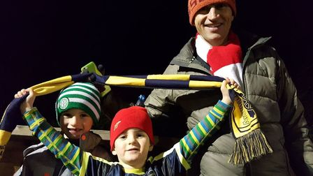 Hitchin resident and huge Arsenal fan Guy Wiseman with his two football-mad sons during the game las