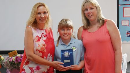 Stonehill School head Elaine Close awards Leah, 11 and Debbie Brookes with a trophy to mark Leah's 1