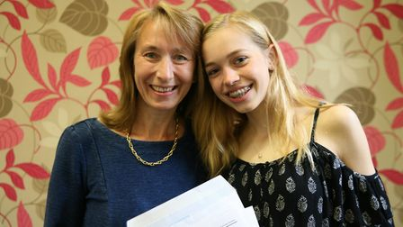 Charlotte Ashwin celebrates after getting her GCSE results with her mother at St Francis' College in
