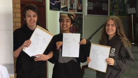 Luke Earl, Shannon Nath and Naomi Wray with their GCSE results. Picture: Fearnhill School