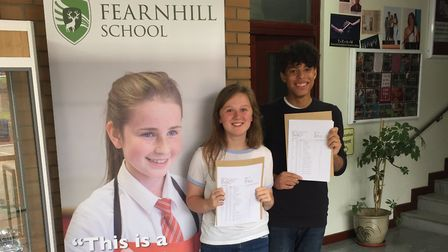 Jessica Payne and Adam Hay with their GCSE results. Picture: Fearnhill School