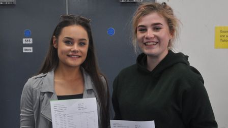Chloe Everton and Katie Alston with their GCSE results. Picture: Samuel Whitbread Academy