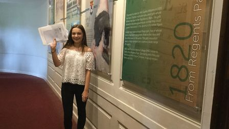 Katie Marlow stands by the Princess Helena College heritage wall with her GCSE results. Picture: Pri