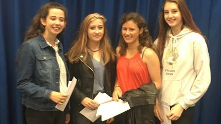Zoe Parnham, Megan Rogers, Abbie Pickard and Lucy French with their GCSE results. Picture: Barnwell