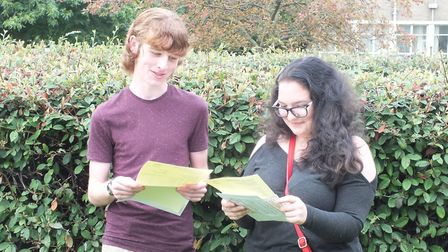 Students Stephen and Effi open their results.