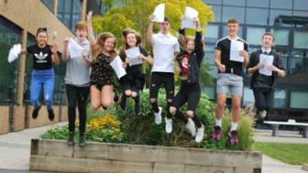 Marriotts School students jump for joy after receiving their GCSE results.