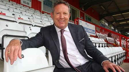 Stevenage FC chairman Phil Wallace asked fans and the community to stand shoulder to shoulder to mak