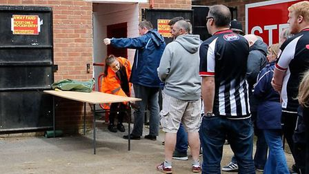 Grimsby Town supporters being searched on the way in to Stevenage FC's Lamex Stadium. Picture: Carlt