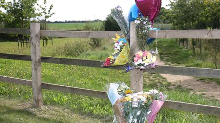 Floral tributes left by the side of Baden Powell Way in Biggleswade after Wayne Jeffs' body was foun