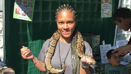 Tina Benson braving a snake at the Animal Crackers event